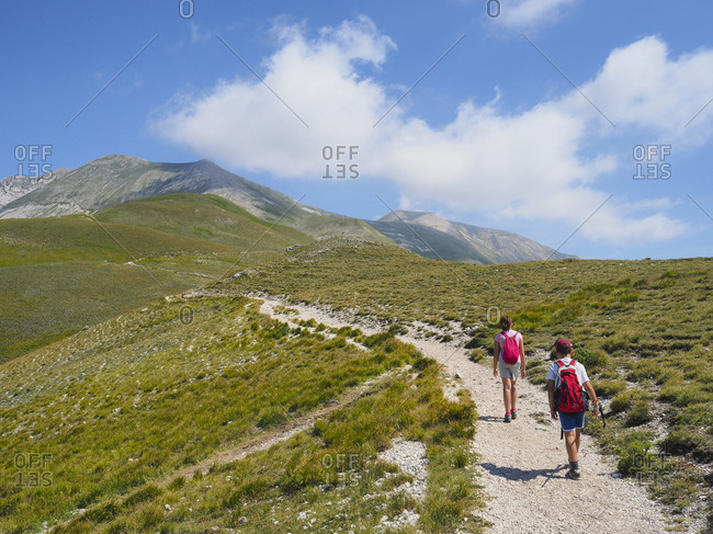 Italy- Umbria- Sibillini mountains- two children hiking mount Vettore
