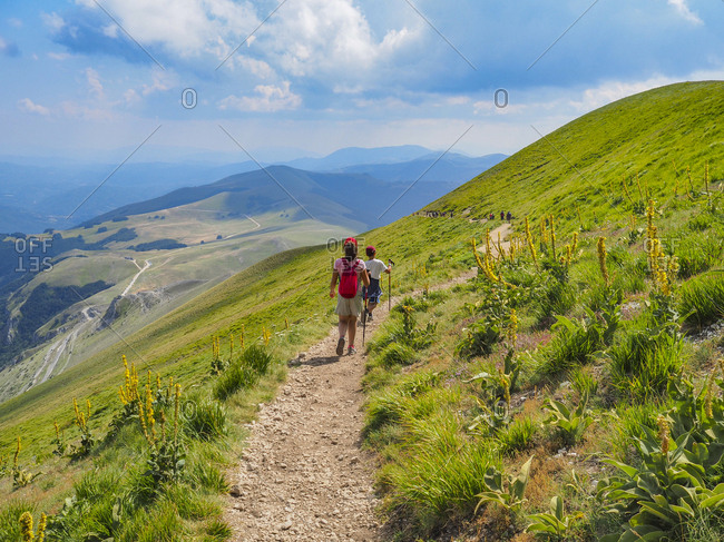 Italy- Umbria- Sibillini mountains- two children hiking mount Vettore