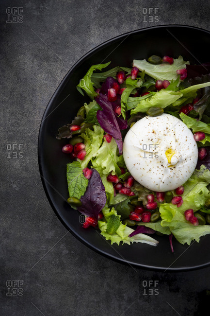Oriental salad with mint- pistachios- pomegranate seeds and burrata cheese