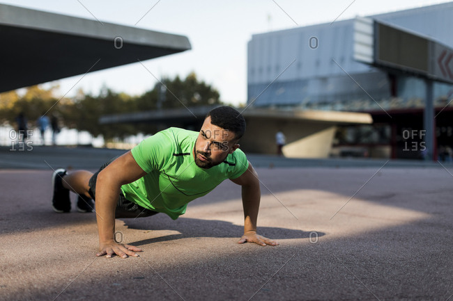 Sportive man during workout- pushup