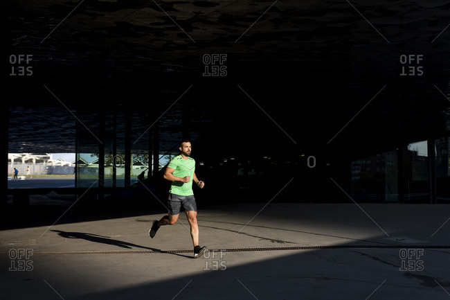 Sportive man during workout- jogging