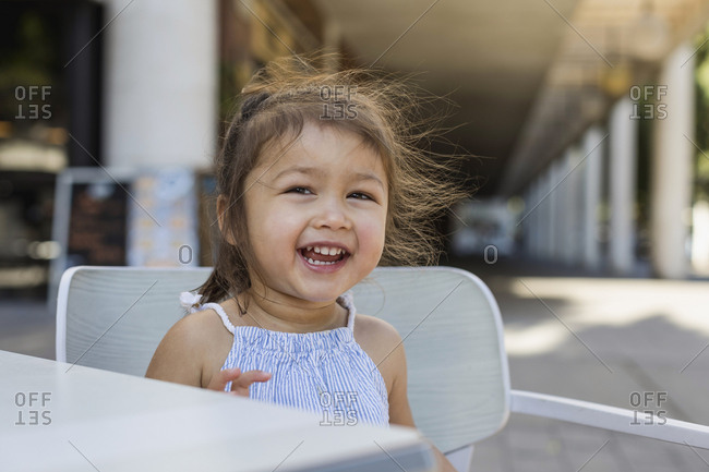 Portrait of happy little girl outdoors