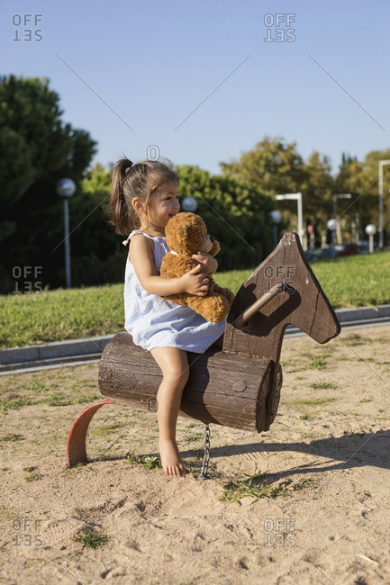 Little girl on rocking horse on a playground