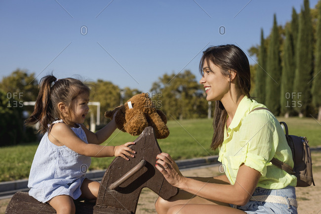 Happy mother with daughter on a playground