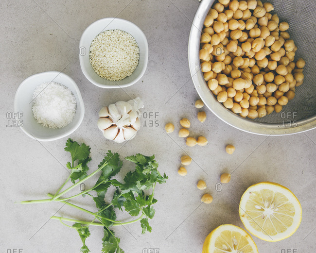 Ingredients for peas hummus- chickpeas- lemon- coriander- garlic- sesame and salt