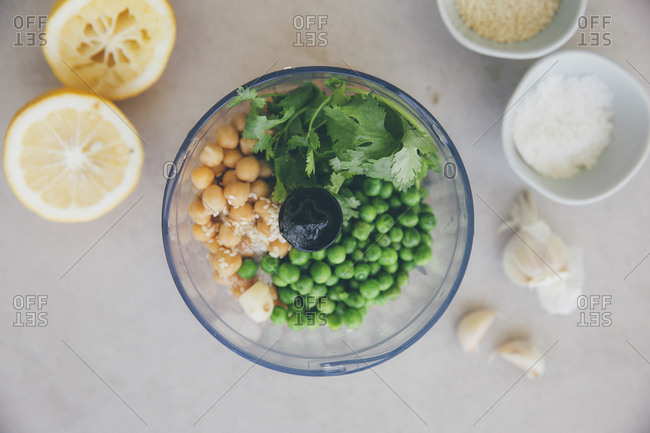 Ingredients for peas hummus- chickpeas- lemon- coriander- garlic- sesame and salt in blender