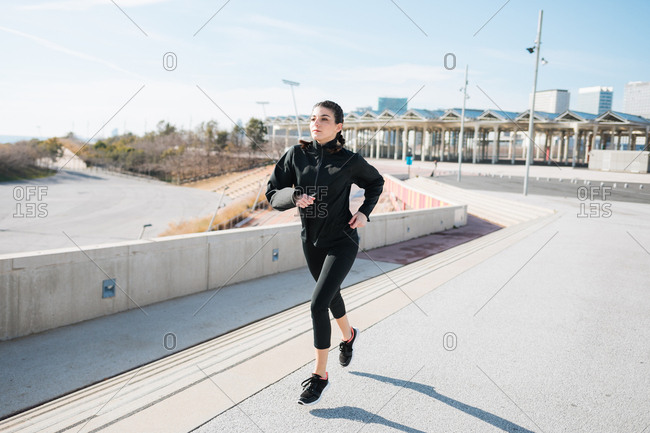 Young woman running and warming up