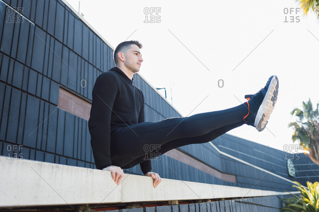 Athletic man stretching