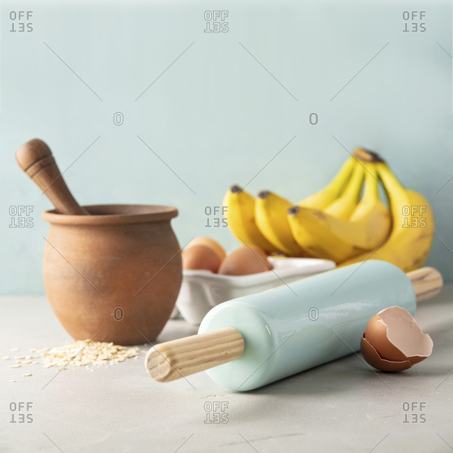 Ingredients for cooking or baking - oats,  bananas, rolling pin, eggs