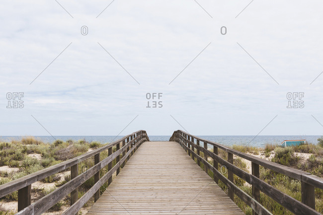 Boardwalk leading to ocean beach, Manta Rota, Algarve, Portugal