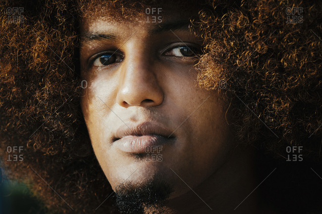 Close up portrait confident, serious young man with afro
