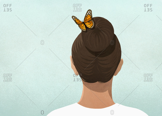 Butterfly in womans hair
