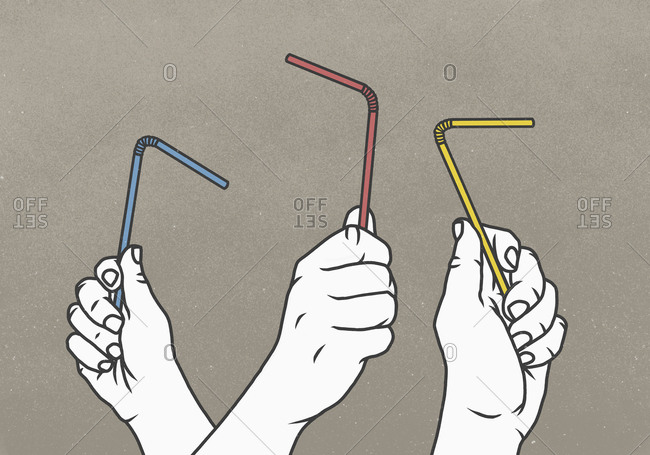 Hands holding multicolor straws