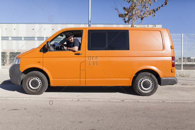 Urgent courier messenger in his orange van