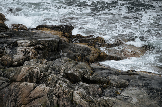 Waves crashing on a rocky shoreline.