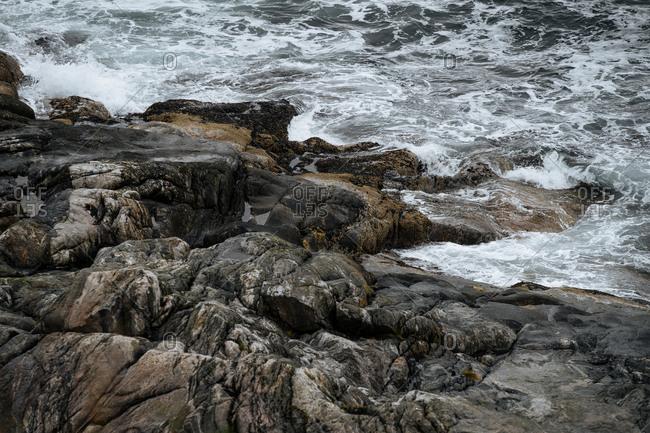 Waves crashing on a rocky shoreline.