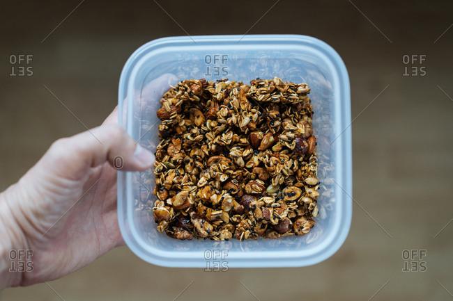 Plastic container of homemade granola