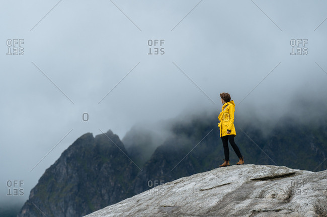 Woman looks to the mountains