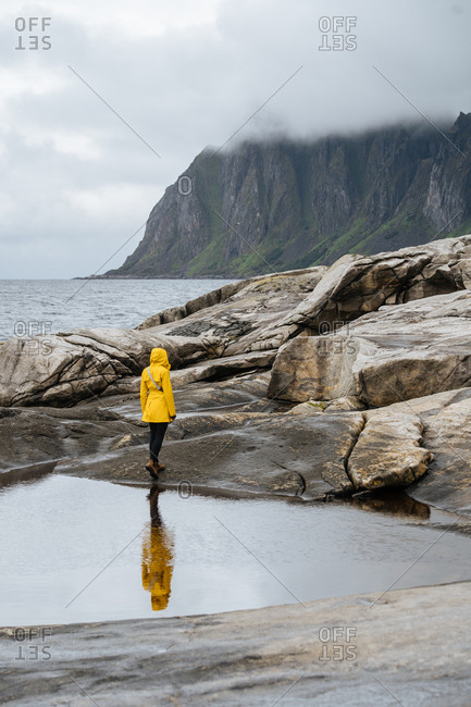 Woman walks on the Norwegian coast