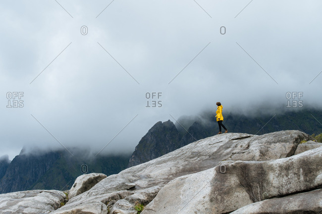 Woman walks on large rocks