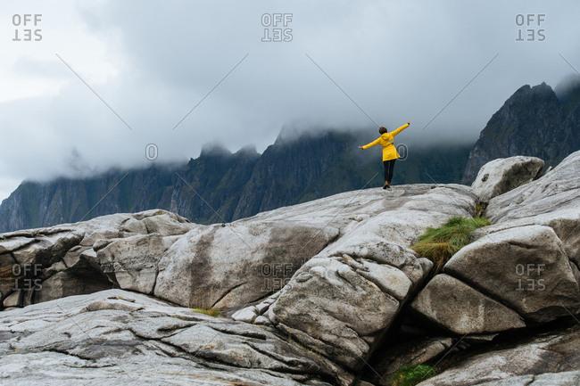 Woman poses on large rocks