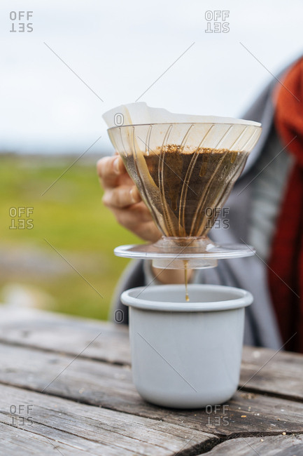 Camper preparing a pour over cup of coffee