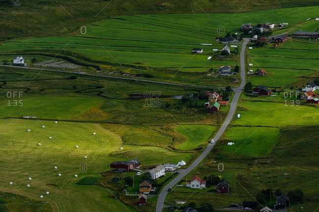 Elevated view over green grass and rural homes on the Lofoten Islands, Norway