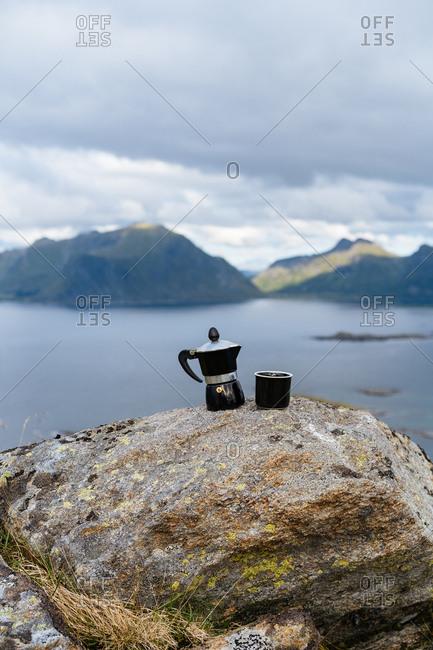 Moka coffee pot on a rock on the coast of the Lofoten Islands, Norway