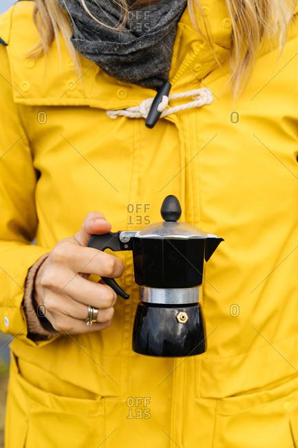 Woman holding moka coffee pot