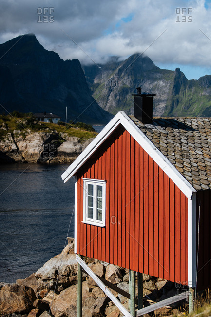Red seaside building on the coast of the Lofoten Islands, Norway