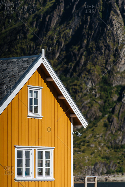 Yellow seaside building on the coast of the Lofoten Islands, Norway