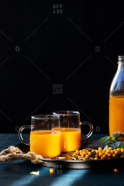 Fresh squeezed juice served in two glasses