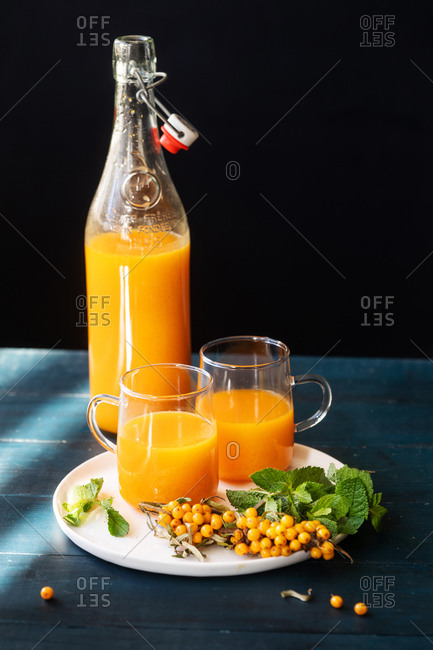 Fresh squeezed juice in a pitcher and served in two glasses