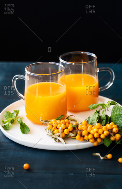 Fresh squeezed juice served in two glasses with berries