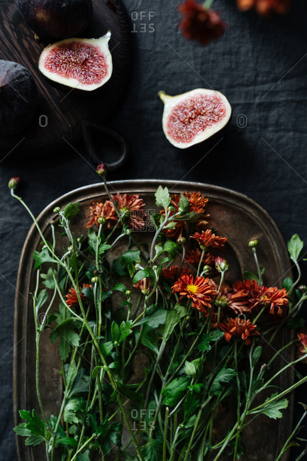 Overhead view of figs and flowers