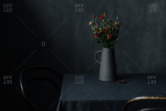 Flowers in a black pitcher