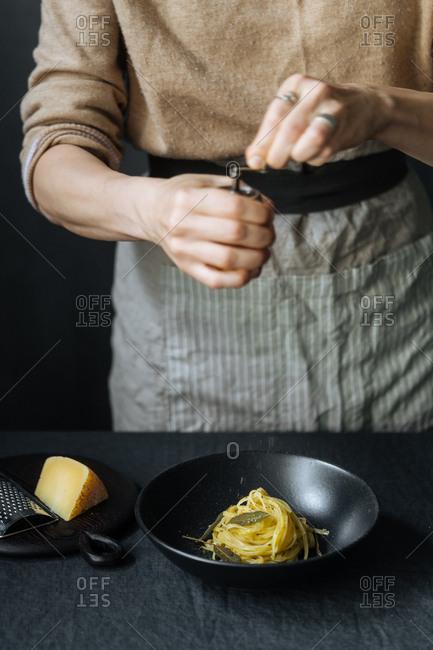 Woman preparing pasta dish