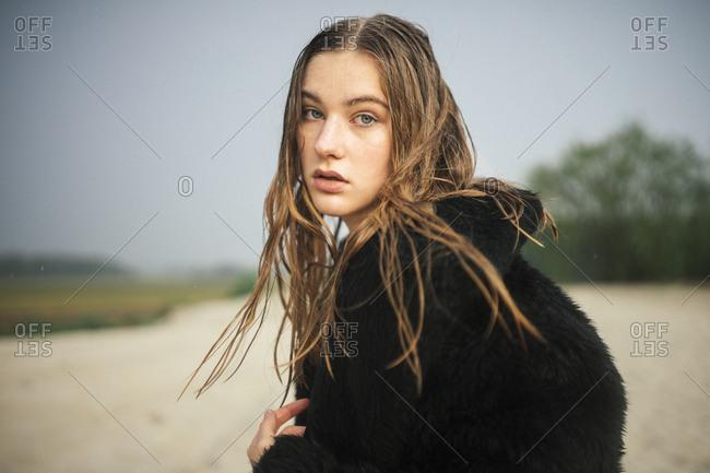 Close up of a woman in a fur coat