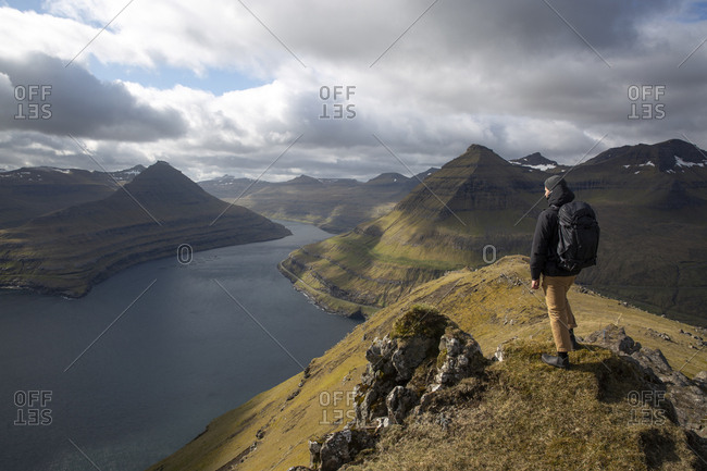 Hiker enjoying the view from the top of mountain