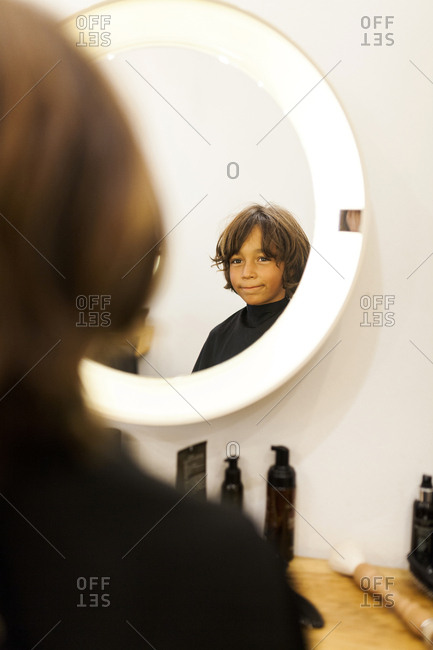 Little boy looking at the mirror