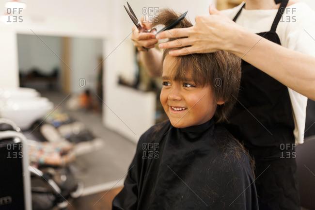 Little boy getting a haircut
