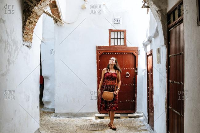 Tetouan, Morocco - September 8, 2017: Woman walking through the medina of Tetouan