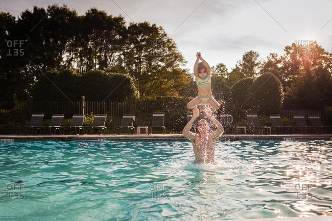 Girl being thrown in the pool