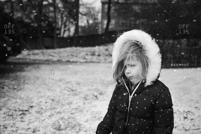 Little girl that does not like snow