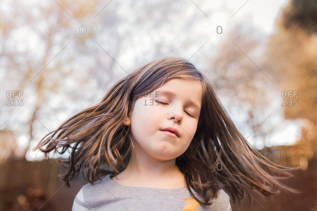 Girl with her eyes closed