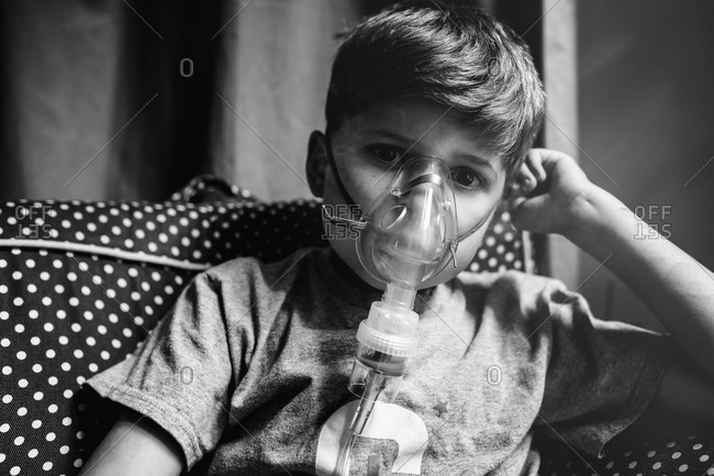 Boy wearing a nebulizer mask