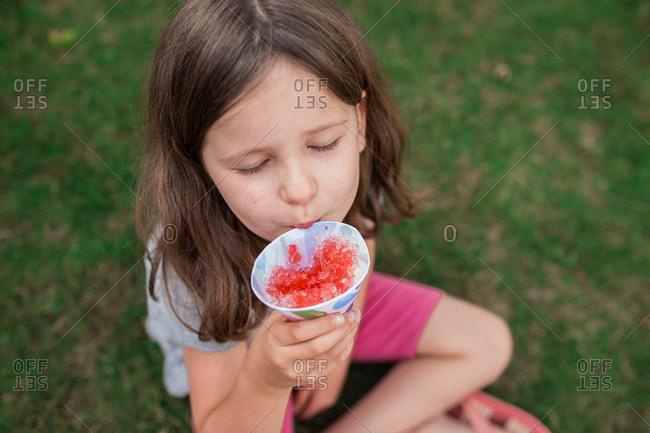 Girl eats snowcone