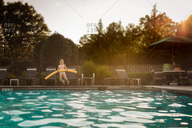 Girl jumping in a pool