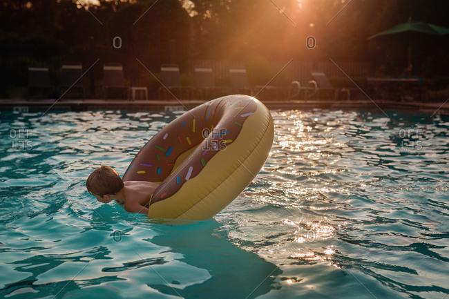 Boy in a pool float