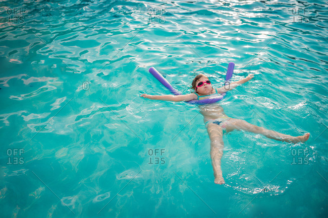 Girl floating in a pool